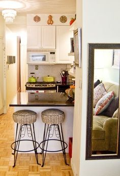 One thing I am currently wishing for in my kitchen is a long bar that is open on both sides. Whenever we have guests at meal-time or while I am cooking my back always has to be to people. It's hard to cook and talk at the same time. Do you have an open bar in your kitchen? Here are a few examples of open bars in small kitchens from this year's Small Cool contest.