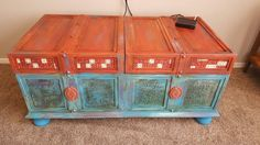 Old trunk turned board game storage..chalk paints , wax, decoupage papers , and metal embellishment