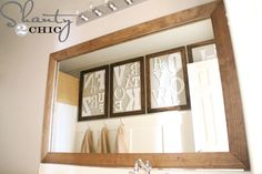 Upgrade the bathroom mirror with a frame and use Command strips to hang it.