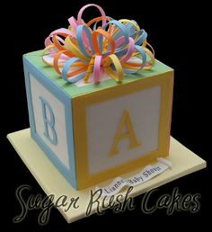 baby shower cake - a large building ABC block with very colorful bow