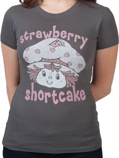This Strawberry ShortCake shirt shows the 80s cutey's smiling face framed by her name.