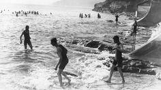 Circa 1911: Eager bathers go for an early morning dip at Scarborough, Yorkshire. (Hulton Archive/Getty Images)