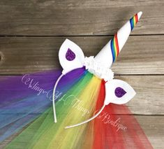A personal favorite from my Etsy shop https://www.etsy.com/listing/278546016/rainbow-unicorn-headband-w-tulle-veil