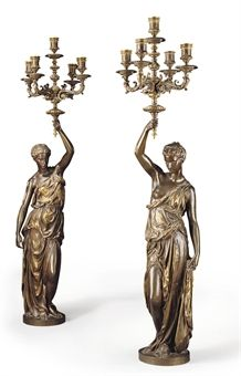 A PAIR OF FRENCH GILT AND PATINATED BRONZE FIGURAL FIVE-LIGHT CANDELABRA