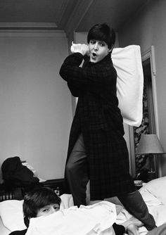 "pinkfled: ""Pillow fight between Paul McCartney and John Lennon at the George V Hotel , Paris 1964 - Photo by Harry Benson """