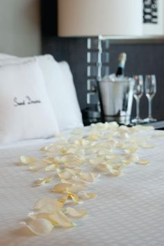 I like the white rose petals so much better than red.....pure class and elegance!!
