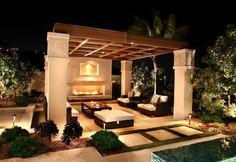 Outdoor fireplace in outdoor living room