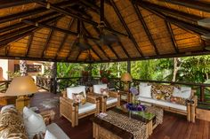 African inspired decor with thatched gazebo. Perfect for outdoor entertaining. Outdoor Barbeque, Barbecue Area, African Hut, Estilo Colonial, Resort Plan, British Colonial Decor, Jungle House, Thatched House, Tropical Backyard