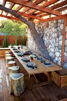 A perfect outdoor getaway! Designer Jamie Durie framed this outdoor dining room by incorporating a large backyard pine tree into a stone wall. The benches are made of simple fallen tree trunks, an easy, inexpensive way to create gorgeous outdoor seating. Backyard Seating, Outdoor Seating, Outdoor Rooms, Outdoor Dining, Dining Area, Outdoor Decor, Dining Room, Large Backyard, Deck Seating