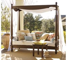 Pottery Barn Balinese Daybed & Canopy.          Doesn't this look dreamy?