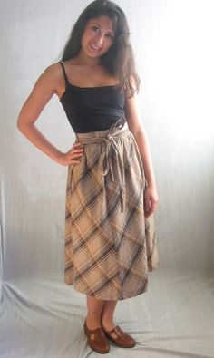 Lovely skirt in autumn colors with a high waist and thick, fixed waist band, and wrap design.