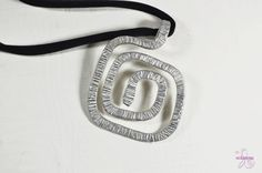 Spiral Square Aluminium pendant with a long cotton by Violanima