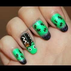 My Halloween nail art design i hand painted of lady Frankenstein on the ring finger with purple and black crackle tips by @daniellem824