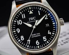 IWC Mark XVIII 3270, 3270-01, IW327001, 327001, stainless steel on a Santoni calfskin strap with a stainless steel tang buckle, automatic IWC caliber 30110 movement, date window at 3 o'clock, scratch resistant sapphire crystal, black dial with Arabic numerals, water resistant to 60 meters/180ft, diameter: 40mm, thickness: 11mm, Like new with original box and papers with full 2 year IWC warranty.