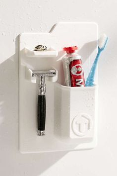 Shop Tooletries Mighty Toothbrush + Razor Holder at Urban Outfitters today. We carry all the latest styles, colors and brands for you to choose from right here. Small Bathroom Organization, Bathroom Storage, Bathroom Ideas, Bathroom Updates, Bathroom Trends, Shower Storage, Bathroom Inspo, Washroom, Bathroom Designs