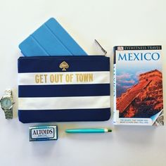 """HPKate Spade 'Get out of town' pouch A coated-canvas pouch from Kate Spade New York. The striped design is set off by a gold-tone badge and a metallic """"Get out of town"""" lettering. Zip top with a lined interior. Multi purpose pouch. Fits iPad mini and your essentials.   MEASUREMENTS Height: 7in / 18cm Length: 10in / 25.5cm Depth: 1in / 2.5cm kate spade Bags Cosmetic Bags & Cases"""