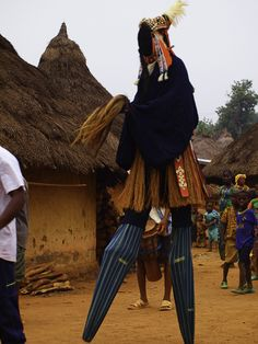 Stilt dancer in #IvoryCoast - we visit this stilt dancing ceremony in Ivory Coast on our overland adventure trips between #Freetown and #Accra