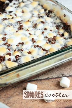This s'mores variation of a dump cake recipe uses chocolate pudding, chocolate cake mix, semi sweet chocolate chips, graham crackers, and toasted marshmallows! A total fool-proof dessert!