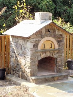 A custom stone pizza oven with damper and chimney. Beauty and funtionality make this pizza oven an invaluable asset in your yard. Would one of these go nicely in your yard?