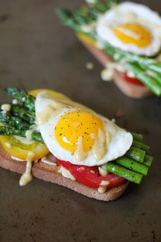 Roasted Asparagus and Tomato Toasts with Mustard Aioli. Could do this with a variety of ingredients.