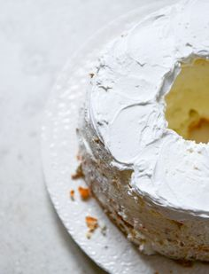Angel Food Layer Cake with Whipped Coconut Cream and Grapefruit Syrup I howsweeteats.com. Splendid.