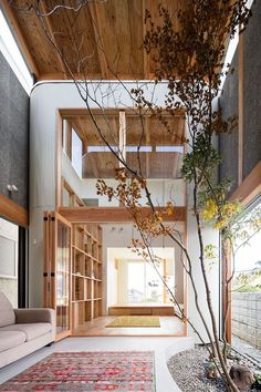 the wood accents and indoor trees are amazing in this home!