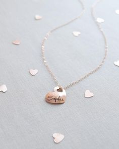 Engraved Heart Name Necklace by Olive Yew. Thank your bridesmaid for all of her help on your big day by giving her a personalized heart charm necklace engraved with her name. Available in silver, gold and rose gold.