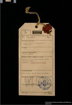 Evidence tag from the trial of Klaus Barbie in Lyon, France. This standard police form lists Barbie's infractions as crimes against humanity and complicity, concepts defined at the International Military Tribunal at Nuremberg decades earlier. The line in which the victims' names would be recorded is left blank. February 25, 1983.  — USHMM Collection, Gift of Radu Ioanid