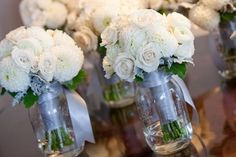 Like the ribbon around the jar with the bouquets in them for the head table!! -Bridesmaid Bouquets Wedding Flowers Photos on WeddingWire
