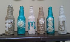 Upcycled glass bottles Family wrapped in twine by StacysHappyPlace