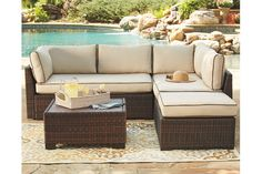 The Loughran 4-piece outdoor sectional set's clean architectural lines and supportive cushioning make being outside even more inviting. All-weather reversible Nuvella™ cushions are finessed with brown piping, and complement the richly hued wicker frames perfectly. Square cocktail table and ottoman cozy up to the sectional with ease.