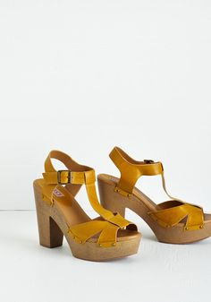 Blogging Miles Heel. When friends check in for your travel updates, theyre thrilled to find photos of you wearing these T-strap platforms from Dolce by Mojo Moxy! #yellow #modcloth