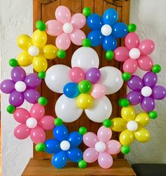 Fresh as Springtime! Big colorful balloon wreath - great decor for Easter or Spring parties and events. 4ft/120cm across, can be hung on wall or from ceiling. Guirnalda de globos para primavera y Pascua.