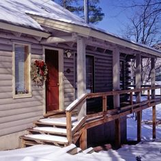 Log home with red door and wraparound porch in winter, decorated with a Christmas wreath Mountain Cottage, Log Home Decorating, Christmas Porch, Cabins In The Woods, Log Homes, Vermont, Wraparound Porch, Custom Design, Rustic