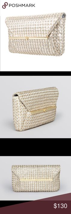 """Tory Burch Quilted Ellie Envelope Metallic Clutch! Metallic silver-tone quilted leather Toy Burch Ellie clutch with gold-tone hardware, gold-tone woven accents throughout, gold-tone bar and logo embellishments at front face, grey woven lining, dual pockets at interior walls; one with zip closure, three card slots at interior walls and fold-in flap closure at front. No dust bag. Hardly used. Excellent condition!  Height: 5"""" Width: 9.75"""" Depth: 1.5 Tory Burch Bags Clutches & Wristlets"""