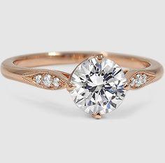 This gorgeous vintage-inspired setting features pavé set diamonds, milgrain detail, and a unique compass point setting.