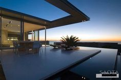 This dramatic contemporary home by SAOTA (Stefan Antoni Olmesdahl Truen Architects) is located in Camps Bay, South Africa.   2