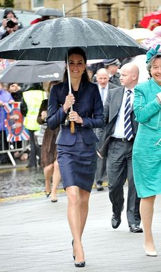 Prince William and Catherine 'Kate' Middleton brave the rain to visit Darwen in Lancashire, April 11, 2011. This is their last official engagement before their wedding on April 29th.