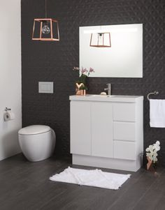 Marble look designs at a fraction of the cost of a tile or slab of granite, or geometric patterns with metallic trims add impact either as a feature wall or with subtle hints of colour.