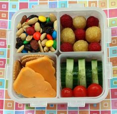 trail mix, golden & red raspberries, whole wheat crackers with cheddar, cucumer slices & cherry tomatoes