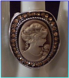 'Victorian Like Cameo Ring Surrounded By Gemstones' is going up for auction at  4pm Sat, May 11 with a starting bid of $1.
