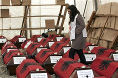 A Kosovo Red Cross volunteer looks at 46 coffins draped with Albanian flags containing the remains of ethnic Albanians killed during the 1998-99 Kosovo war in capital Pristina on Monday, March 24, 2014. (AP Photo/Visar Kryeziu) ▼24Mar2014AP|Remains of 46 Kosovo victims handed to families http://bigstory.ap.org/article/remains-46-kosovo-victims-handed-families #Albanian #Pristina #Kosovo