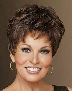 Winner by Raquel Welch is under two ounces in weight, a pixie with barely waved layers that can be teased up or combed down. Features razor-like tapering of barely waved layers. With a firm shake this Raquel Welch style is ready to wear right out Short Grey Hair, Short Hair With Layers, Short Hair Cuts For Women, Layered Hair, Short Hairstyles For Women, Gray Hair, Long Hair, Pixie Hairstyles, Braided Hairstyles