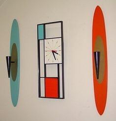"""Peter Pepper Products"" Orange and Blue Wall Sconces with a Sunbeam Clock 