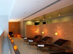 SPA NOI, HOTEL NOI VITACURA  Santiago de Chile, Chile    Who but a former model (the long-legged Virginia Paniagua) could have helped design such a versatile, results-focused spa menu? Dusky lanterns and candles infuse the stone interior with a rich mandarin hue.