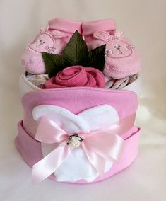Ideal Gift for Baby Showers. Large range of Stylish Nappy Cakes available. Unique and practical baby gift. Baby Shower Cupcakes, Baby Shower Parties, Baby Shower Themes, Baby Shower Gifts, Shower Ideas, Pink Diaper Cakes, Nappy Cakes, Baby Bouquet, Baby Mittens
