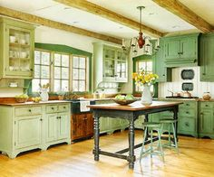 Love the layout and island in this kitchen. Not crazy about the color.