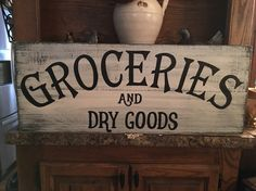 Hi there, this sign is approx. 30 long X 12 wide. It is done with layers of black underneath a white wash with heavy distressing and sealed with stain. Lettering is done in black. Would look great in a french or farmhouse style kitchen! Wire hanger on back for easy hanging.   All of our signs are made from rough sawn or repurposed lumber. We do not attempt to cover up any imperfections in the wood (i.e. knots grains, nail holes, cracks, etc.) We think these add special character and make…