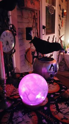 My crystal ball was made with purple string lights tucked inside a ceiling light bulb cover. It looked amazing with my jumbled fortune teller table and witchy porch!