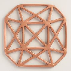 With a geometric design finished in copper, our large trivet is an exclusive statement piece that protects your countertop.